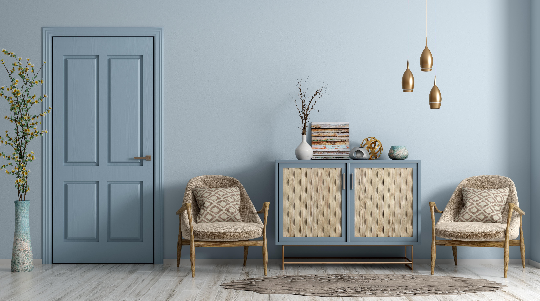 Intérieur moderne d'un salon avec porte, fauteuils et commode rendu bleu pâle peintures mf